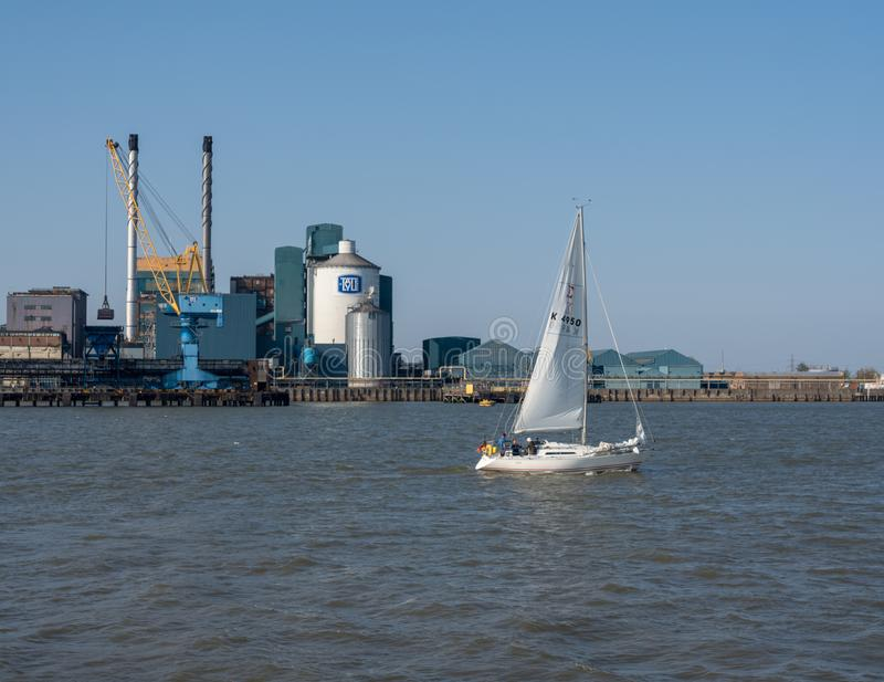 Tate and Lyle sugar refinery by river thames in London stock photography
