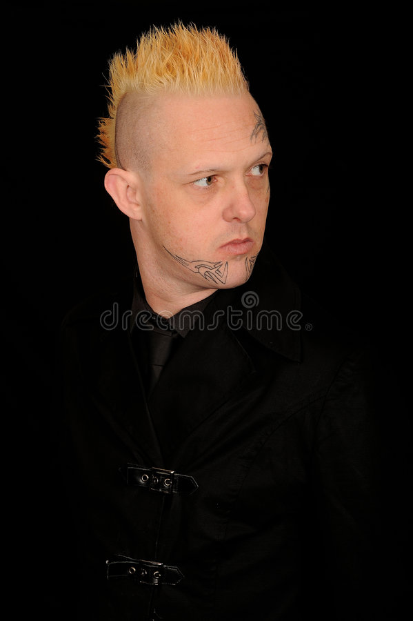 Tatooed punk man stock photography