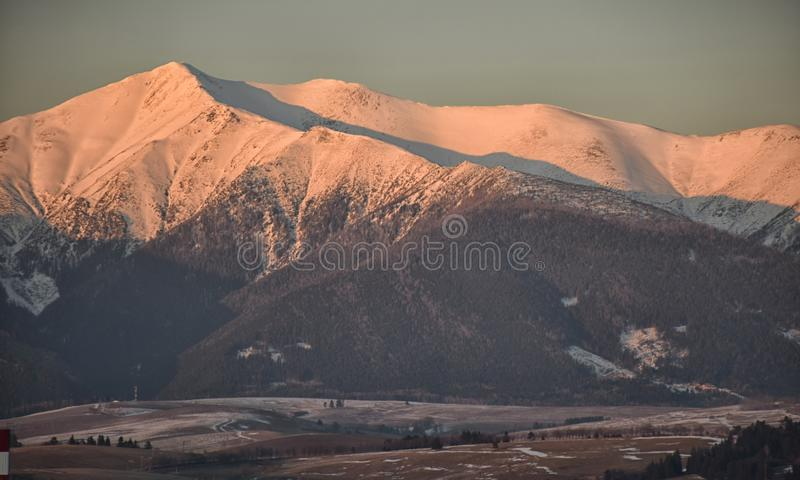 Tatra mountain peaks evening light, winter evening, slovakia mountains and rocks covered with snow, overcast winter day. Tatra mountain peaks evening light royalty free stock image