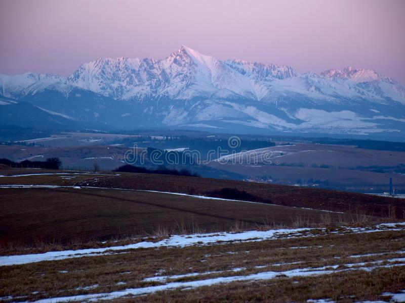 Tatra mountain peaks evening light, winter evening, slovakia mountains and rocks covered with snow, overcast winter day. Tatra mountain peaks evening light royalty free stock photo