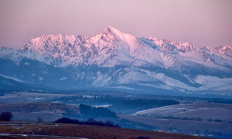 Tatra mountain peaks evening light, winter evening, slovakia mountains and rocks covered with snow, overcast winter day. Tatra mountain peaks evening light stock image