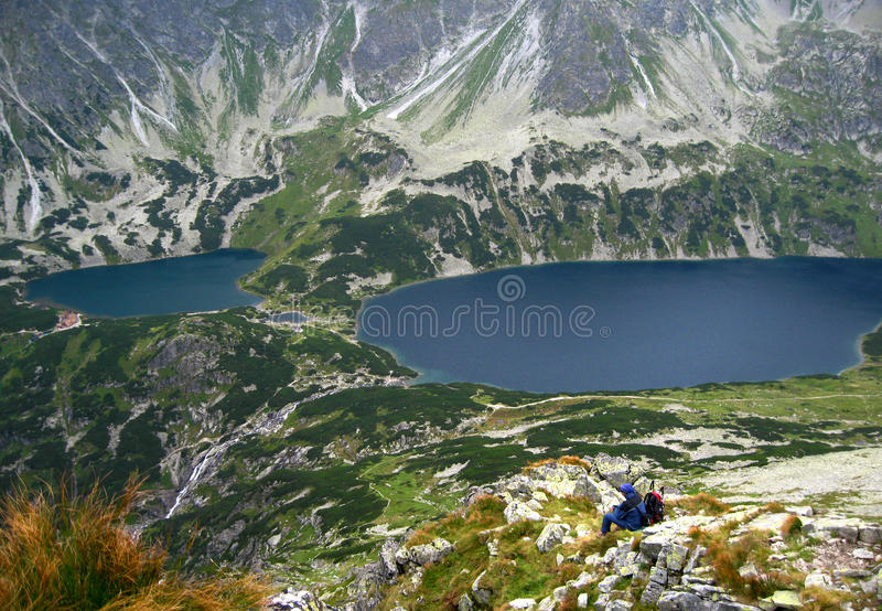 Tatra mountains in Poland, green hill, valley and rocky peak in the sunny day with clear blue sky. Tatra mountains in Poland, The valley of five Polish lakes royalty free stock photos