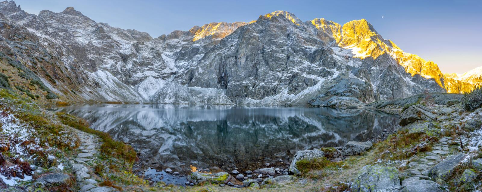 Tatra National Park, a lake in the mountains at the dawn of the sun. Poland stock photos