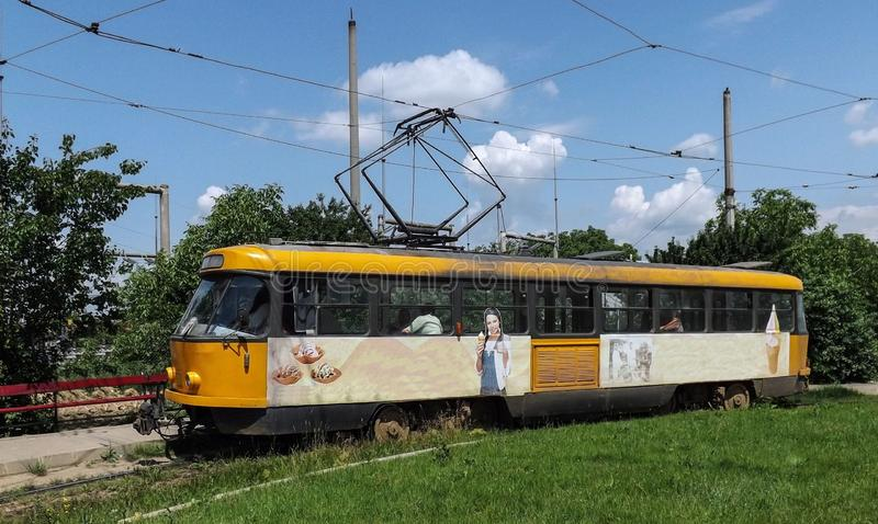Tatra T4, tram from Botosani. T4 is the name of a tram produced by ÄŒKD Tatra. This model is an T4 from Botosani, Romania stock photography
