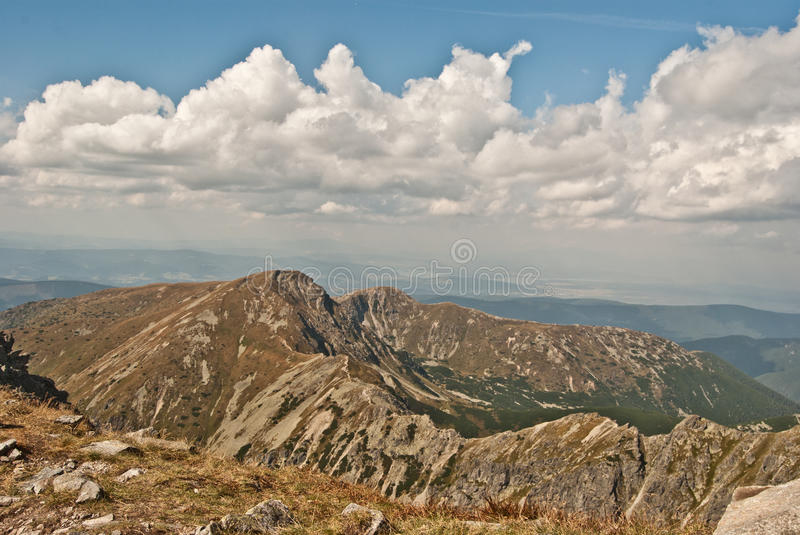 Tatry mountains panorama from Spalena peak in Rohace. Panorama of Zapadne Tatry mountains with many peaks and lake from Spalena peak in part of Tatry mountains stock photo