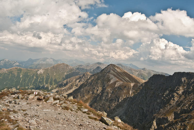 Tatry mountains panorama. Panorama of Zapadne Tatry mountains with many peaks and lake from hiking trail between Spalena and Pachola peaks in part of Tatry royalty free stock photos