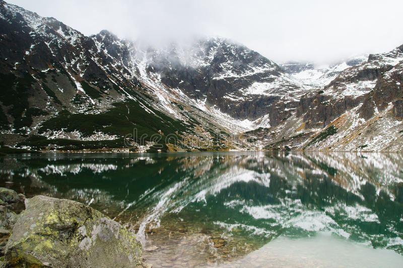 Tatry mountains a remarkable reflection in water. A baeutiful view on beautiful black lake in Tatry mountains, Poland royalty free stock images