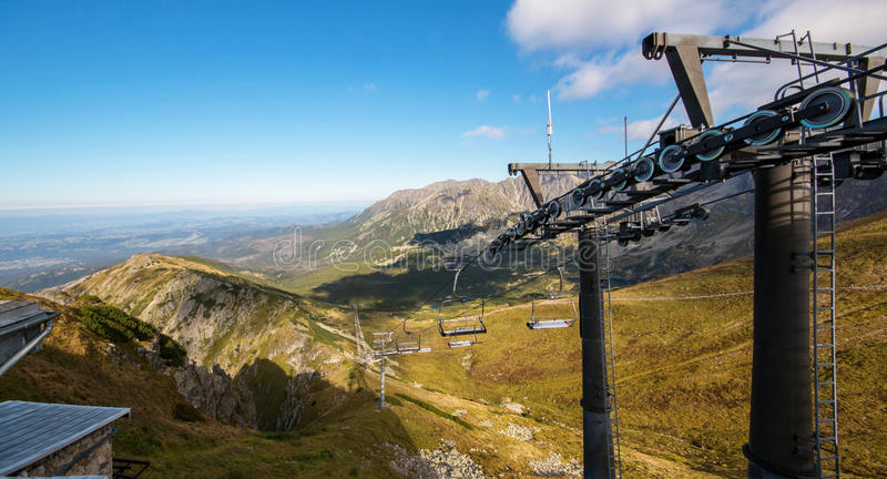 Tatry. Poland and Slovakia boundary, autumn landskapes. Tatry. Poland and Slovakia boundary, autumn landskapes with chairlift. Big panorama photo stock image