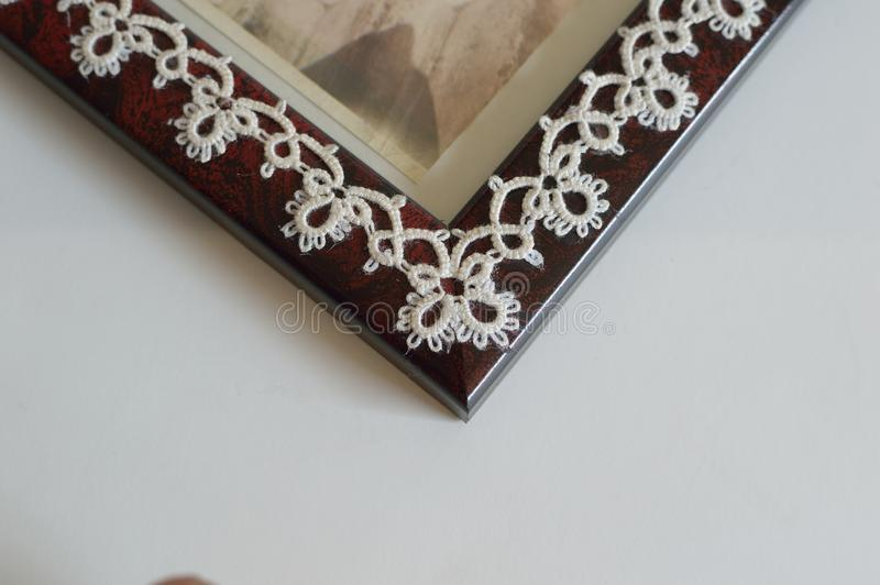 Closeup Corner detail Fine Thread Tatted Edging Picture Frame royalty free stock photography