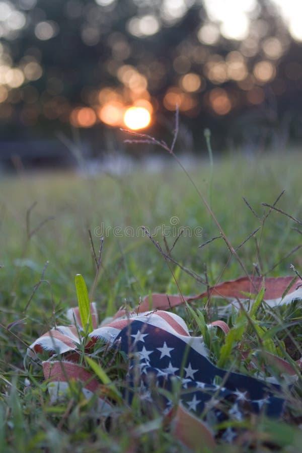 Tattered flag at sundown
