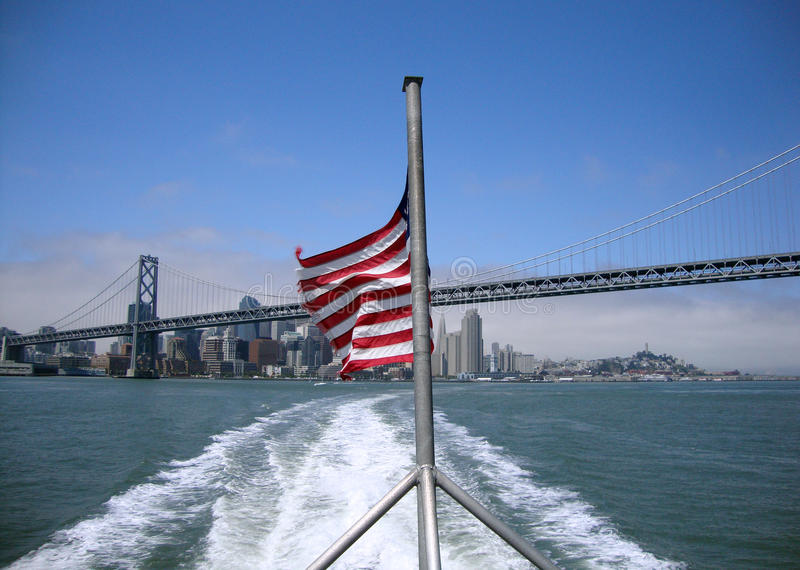 Tattered Flag Waves In Wind On The Back Of A Ferry Royalty Free Stock Photo