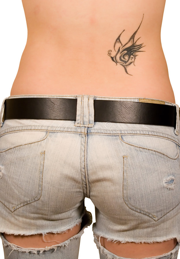 Tattoo. On a back of the girl royalty free stock photo