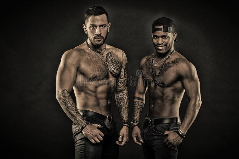 Tattoo addicts. Sexy men with muscular torso. Brutal macho style. Muscular men with fashionable tattoo style. Looking. Sexy, vintage flter stock photo