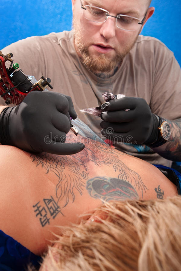 Download Tattoo Artist and Customer stock photo. Image of body - 22215662