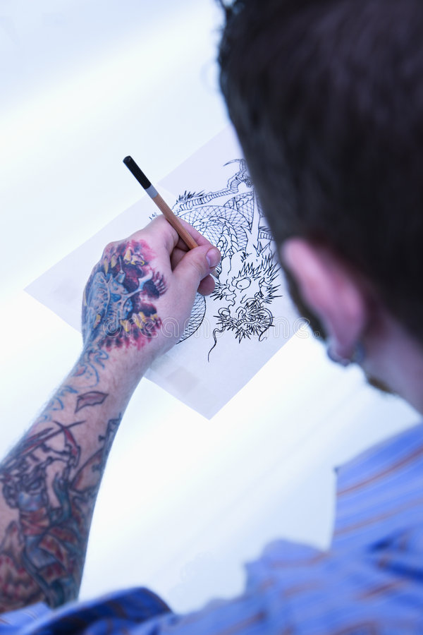 Download Tattoo artist drawing. stock image. Image of person, light - 2677999