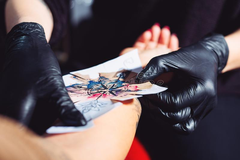 Tattoo artist in a studio. Close up picture royalty free stock photos