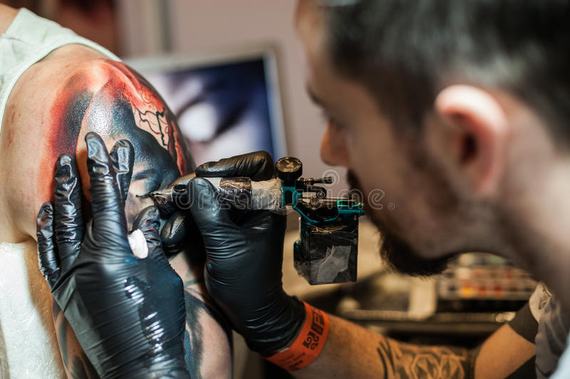 Tattoo artists at work royalty free stock photo
