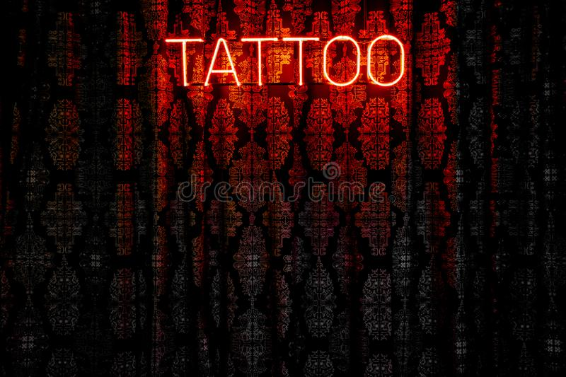 Tattoo black and red one. Tent with neon sign and lettering Tattoo stock image