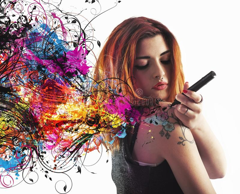 Tattoo draw. Girl draws a tattoo on his arm royalty free stock photos