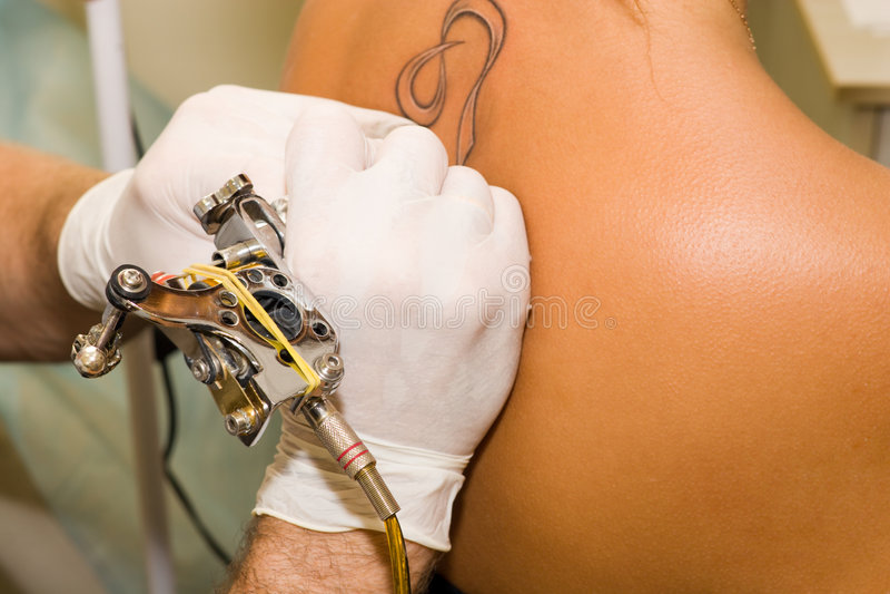 Tattoo making stock photos