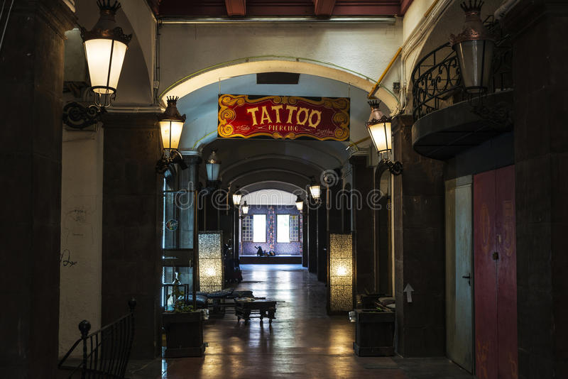 Tattoo and piercing shop in the old town of Barcelona royalty free stock photography