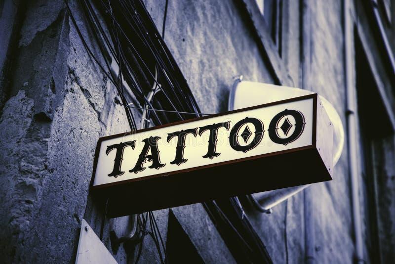 Tattoo hall sign stock photo