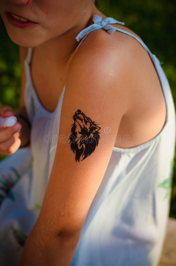 Tattoo of wolf on the shoulder stock images