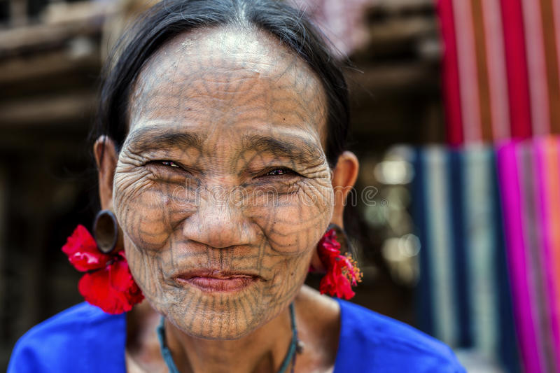 Tattooed faced Chin Tribe Woman, Myanmar. Mrauk-U, Myanmar - January 30, 2016. A portrait of Chin tribe woman with spider tattoo on her face. Chin people, also royalty free stock image