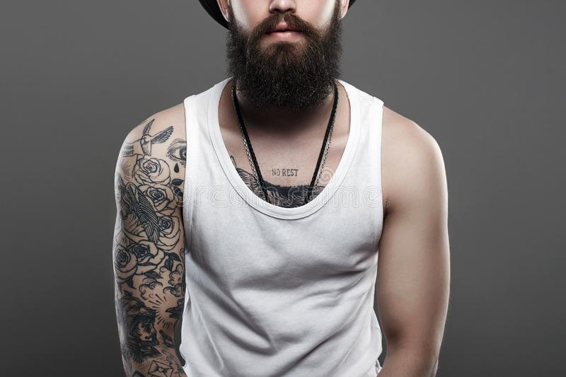 Tattooed handsome Bearded Man. portrait. stock photo