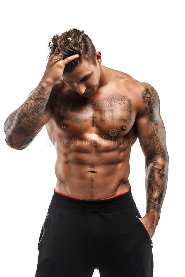 Tattooed muscular guy royalty free stock images