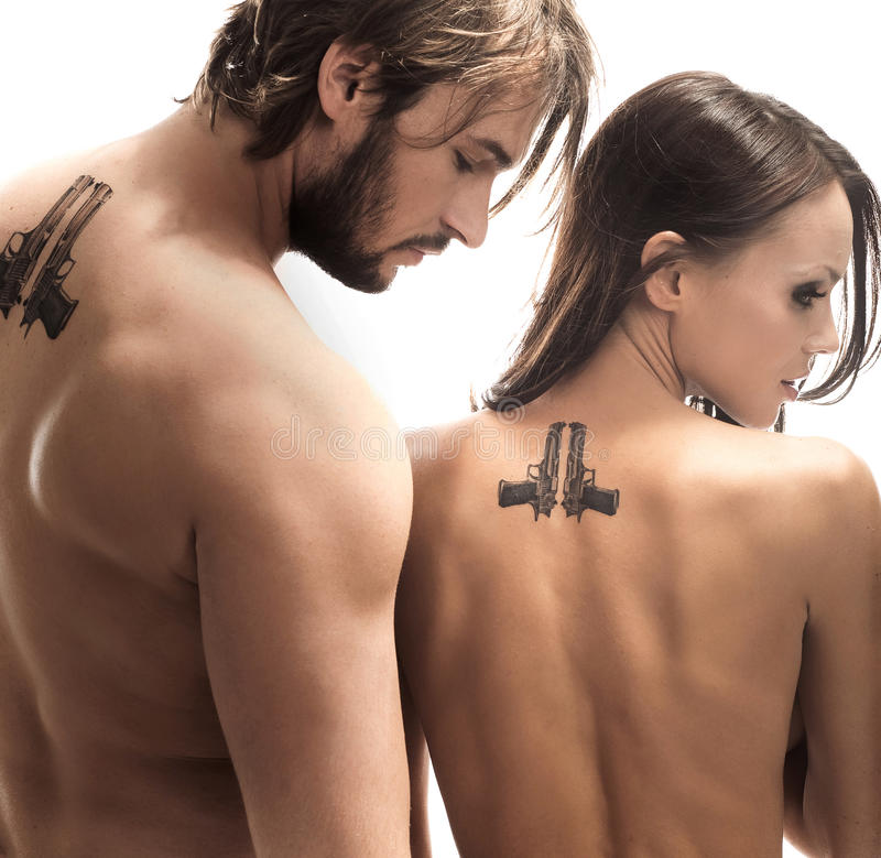 Tattoos. Beautiful couple turned away with tattoos on the back