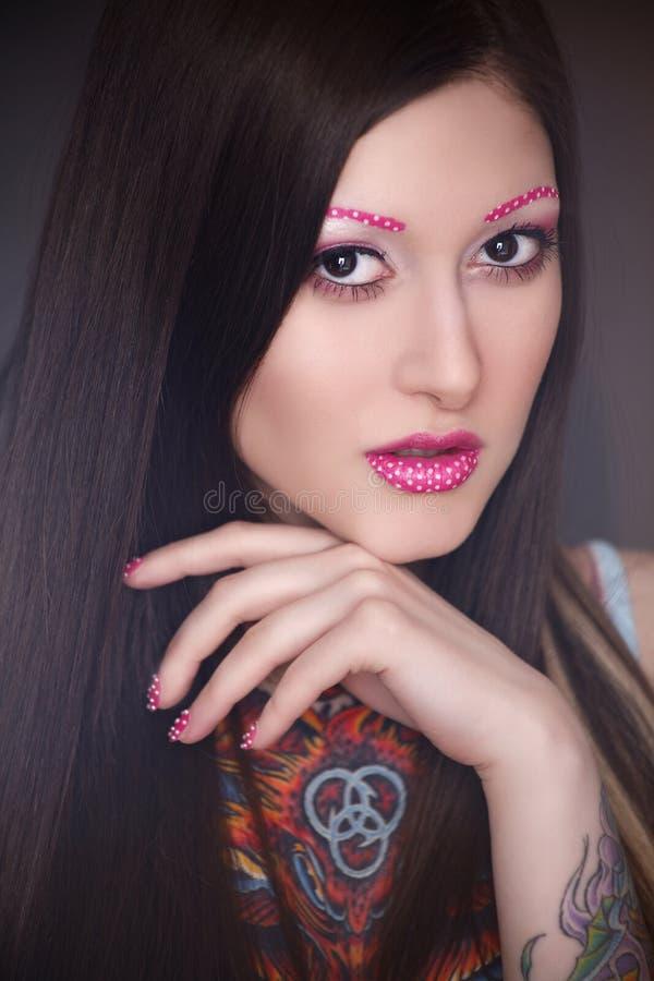 Tatuażu model z jaskrawym makijażem fotografia royalty free