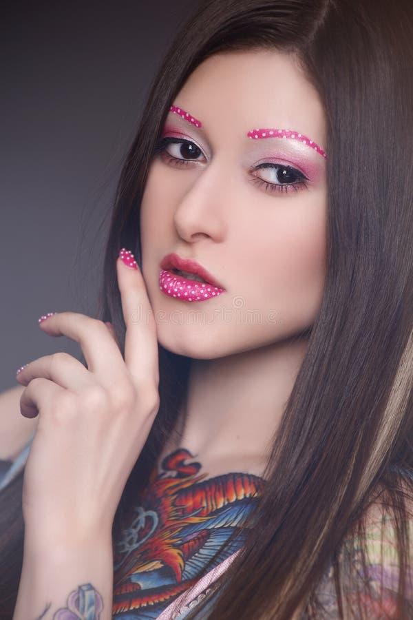 Tatuażu model z jaskrawym makijażem fotografia stock