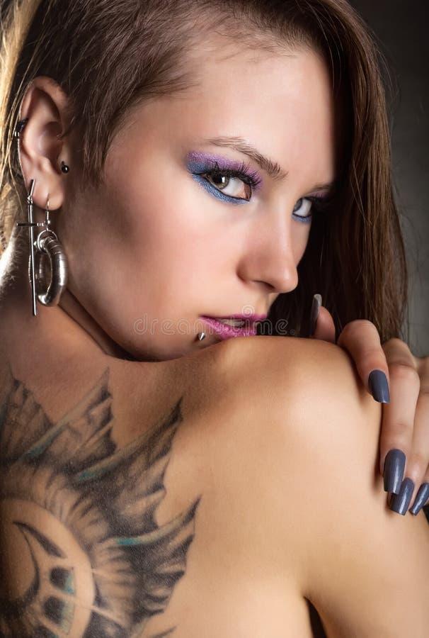 Tatuagem e perfurações foto de stock royalty free