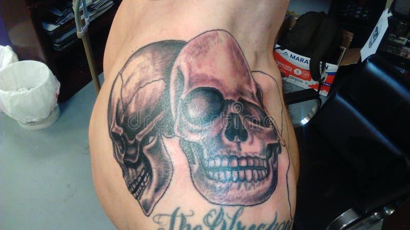 Tatuaggio del cranio fotografia stock