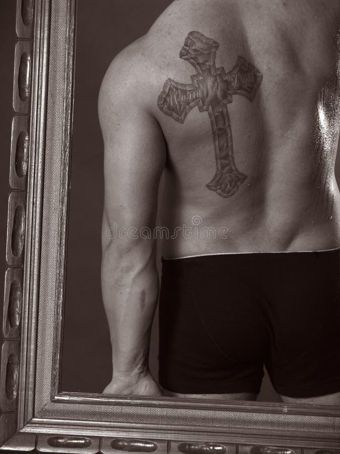 Tatuaggio trasversale fotografia stock