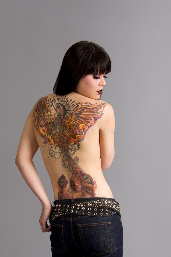 tatueringkvinna royaltyfri bild