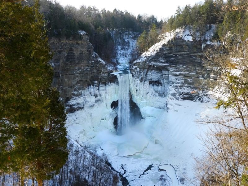 Taughannock Falls glacial carved basin in winter. Taughannock Falls State Park offers hiking and nature trails, camping and picnicking. The park includes a stock photography