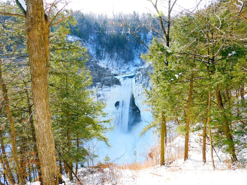 Taughannock Falls tinted in a blue haze below. Taughannock Falls State Park offers hiking and nature trails, camping and picnicking. The park includes a stretch royalty free stock photography