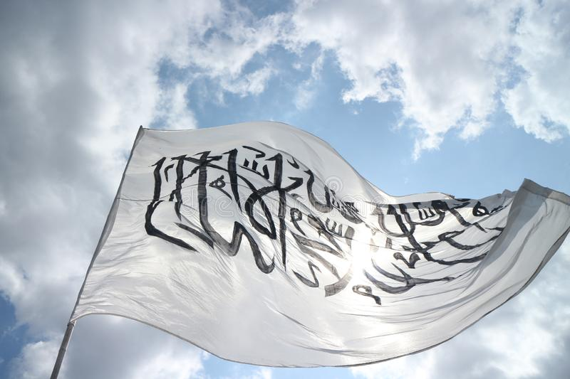 Tauhid Flag with blue sky background. Tauhid flag with blue sky. nvarious groups gave peace speeches to defend palestine, the speech was centered at titik 0km royalty free stock photo