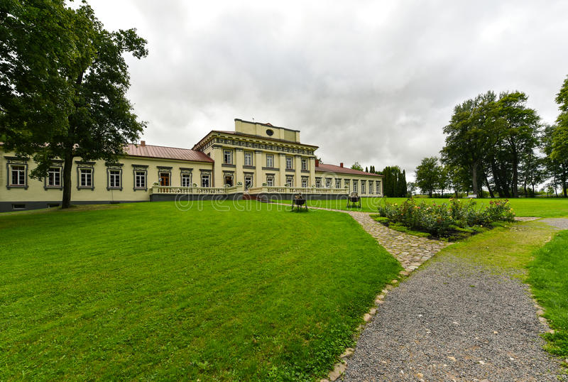 Taujenai manor, Lithuania. Taujenai Manor is a classical-style palace, former residential manor of the Radziwill family in Taujenai, Lithuania. Currently it is royalty free stock photography