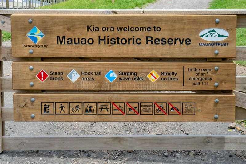 Tauranga, New Zealand - January 15, 2018: Mauao Historic reserve, Mount Maunganui. Sign explaining the reserve of Mount Maunganui, Tauranga, New Zealand stock images