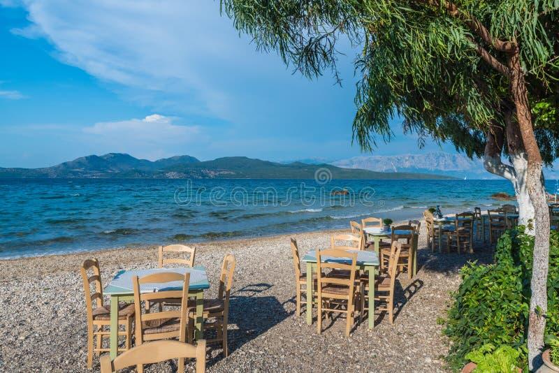 Taverna with table and chairs on Nikiana beach royalty free stock photo