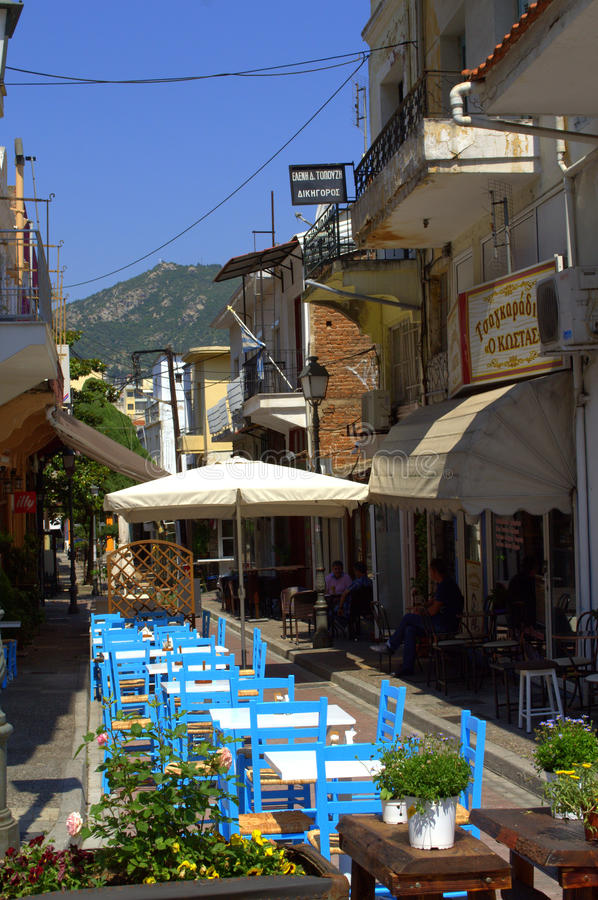 Taverns on narrow street Kavala Greece royalty free stock photo
