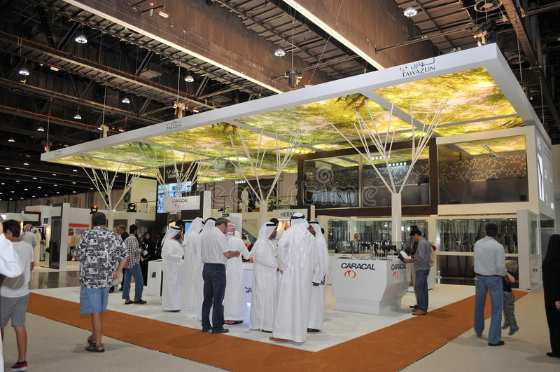 Tawazun weaponry pavilion at Abu Dhabi International Hunting and Equestrian Exhibition 2013. Peoples checking guns at Tawazun pavilion Abu Dhabi International royalty free stock photo