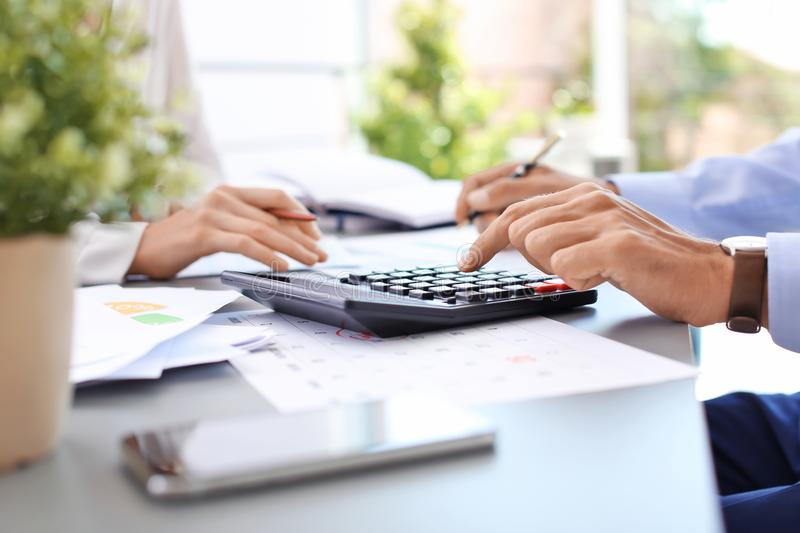 Tax accountants working with documents. At table stock images