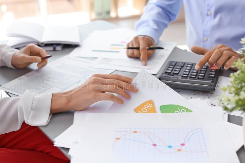 Tax accountants working with documents. At table royalty free stock photos