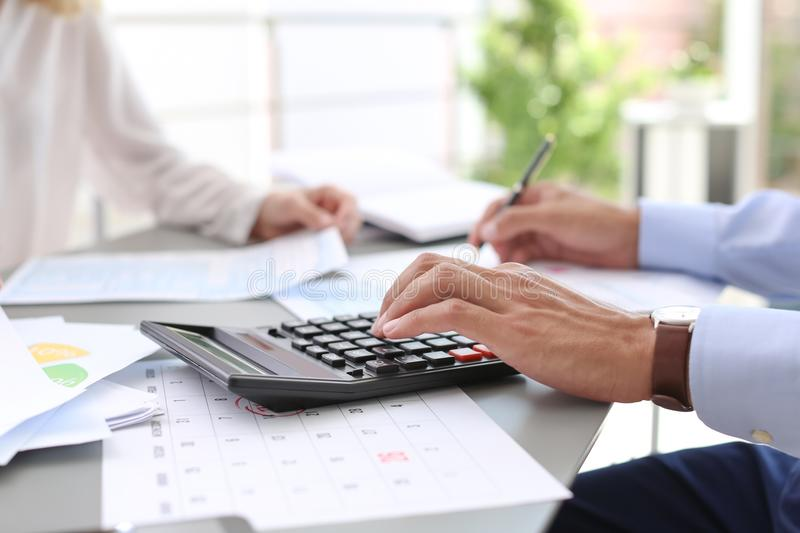 Tax accountants working with documents. At table stock photo
