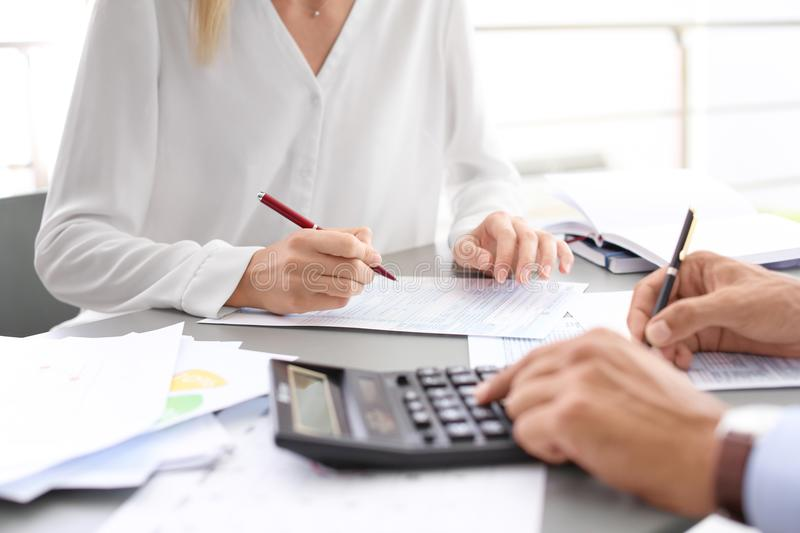 Tax accountants working with documents. At table royalty free stock photography