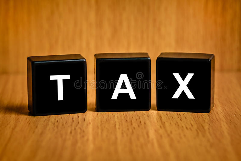 Tax accounting text on block. Tax accounting text on black block , business concept stock photography